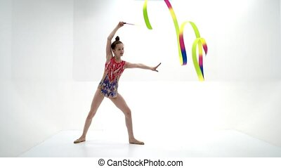 A girl gymnast performs exercises with a mace. - Beautiful...