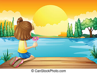 A girl holding a flower facing at the river