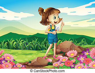 A girl holding a shovel at the flower garden