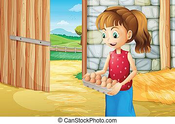 A girl holding an eggtray inside the barnhouse
