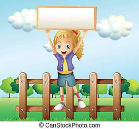 A girl holding an empty frame standing above the fence