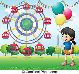 A girl holding balloons at the carnival