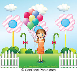 A girl holding balloons in the garden