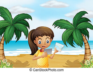A girl holding pictures at the beach