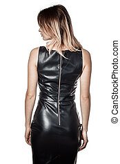 girl in a black leather dress turned her back on a white background