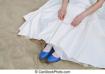 A girl in bright blue shoes