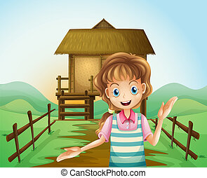 A girl in front of the nipa hut