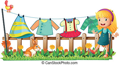 Illustration of a girl in the garden in front of the hanging clothes on a white background