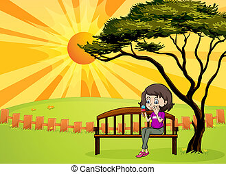 A girl in the park sitting in the wooden bench -...