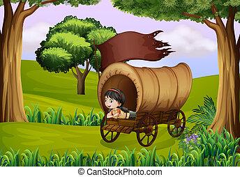 A girl inside the wagon