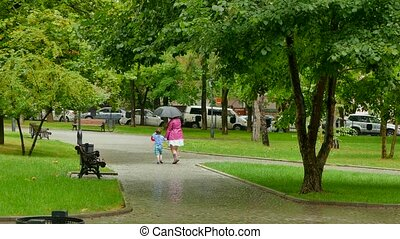 A girl is circling a boy in the rain