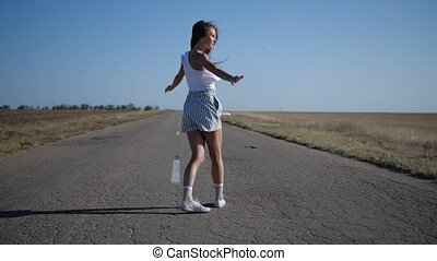 A girl is walking on a road