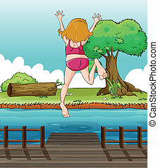 A girl jumping at the wooden bridge