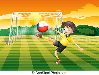 A girl kicking the ball with the Chile flag