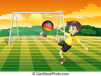 A girl kicking the ball with the flag of Germany