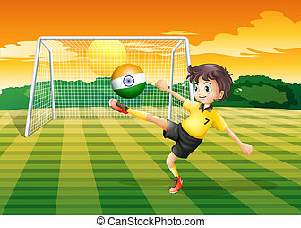 A girl kicking the ball with the Indian flag