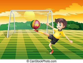 A girl kicking the ball with the Sri Lanka flag