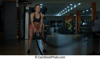 A girl making an exercise in a gym