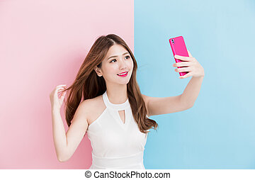 A girl making selfie photo