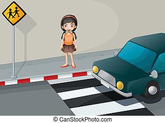 A girl near the pedestrian lane with a car