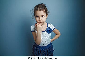 a girl of seven European appearance brunette stuck a finger...
