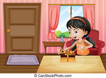A girl opening her gift inside the house