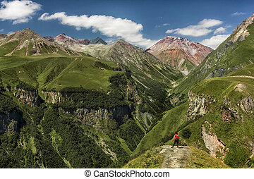 A girl overlooking to the Devil's Valley in the Caucasus mountains