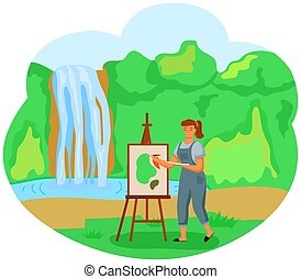 A girl paints a landscape standing in the glade near a waterfall and green trees on the background
