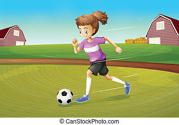 A girl playing football at the farm