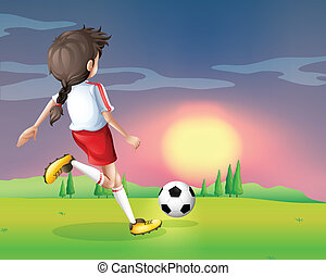 A girl playing football in the afternoon