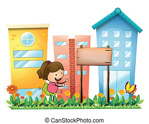 A girl playing in the garden beside a wooden signboard