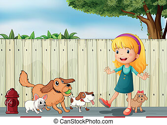 A girl playing with her dogs