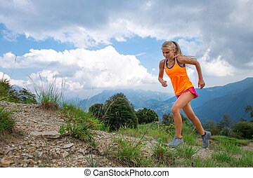 A girl practice running on trail in the mountains