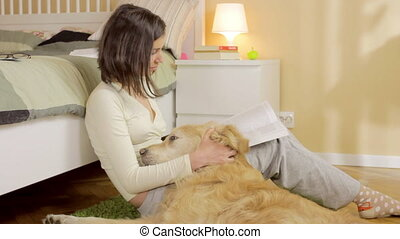 A girl reading book with her dog