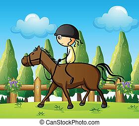 A girl riding on a horse