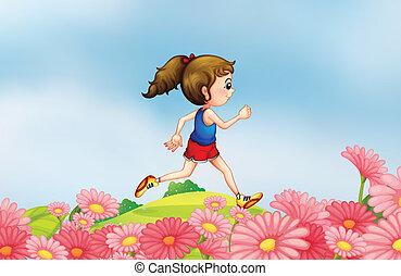 A girl running along the hill with a garden