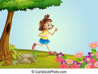 A girl running in a garden