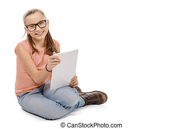 girl seating the floor with a tablet computer