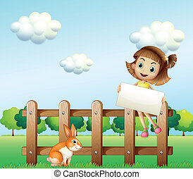 A girl sitting on a wooden fence holding an empty signage