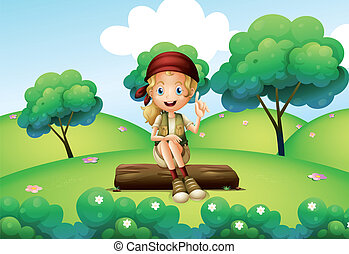 A girl sitting on the trunk at the hill