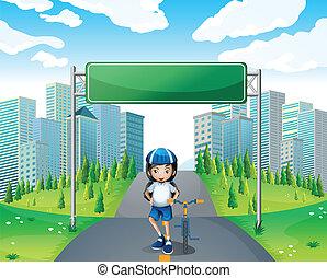 A girl standing below the empty signboard