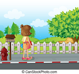 A girl standing near the mailbox at the roadside