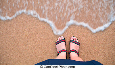 A girl standing on the beach.