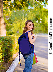 A girl student with a backpack