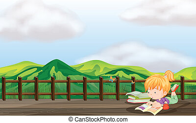 A girl studying at the wooden bridge