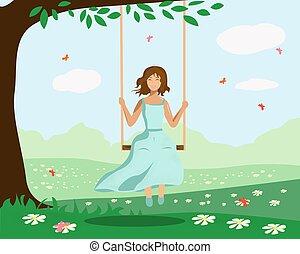 A girl swings on a swing near a tree
