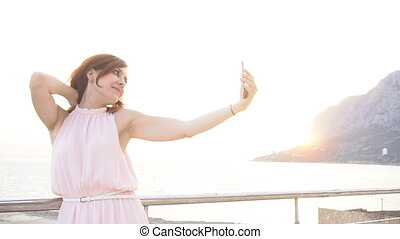 a girl takes pictures of themselves on the phone on vacation...