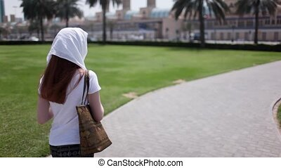 a girl tourist in a headscarf in the United Arab Emirates