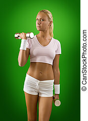 a girl training with two dumbbells