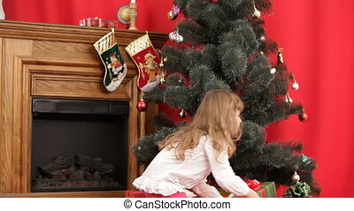 A girl under a Christmas tree
